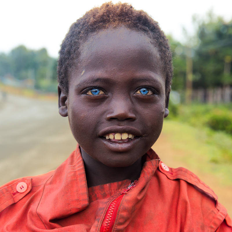 The Boy With The Blue Eyes An African Moments Story By
